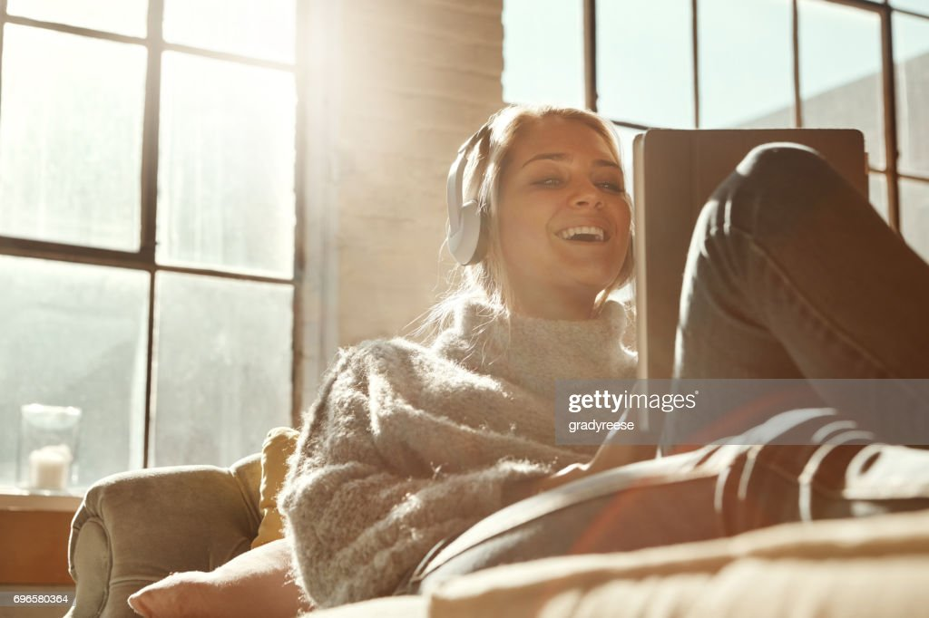 Smart technology's got her entertainment covered : Stock Photo