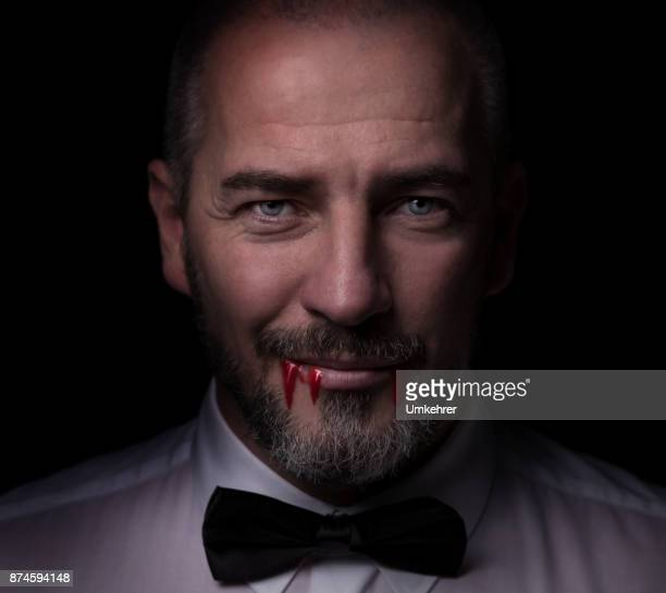 smart vampire with blood - count dracula stock photos and pictures