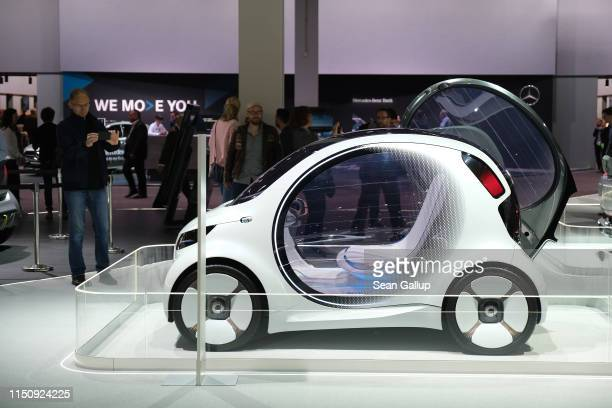 Smart Vision EQ fortwo car stands among vehicles on display at the annual Daimler AG shareholders meeting on May 22, 2019 in Berlin, Germany. Daimler...