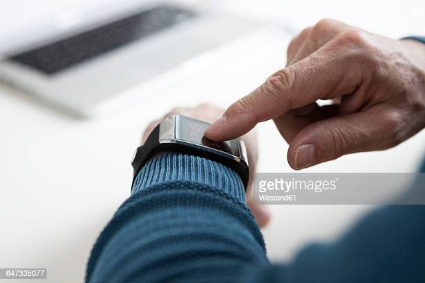 Smart watch on arm of mature man