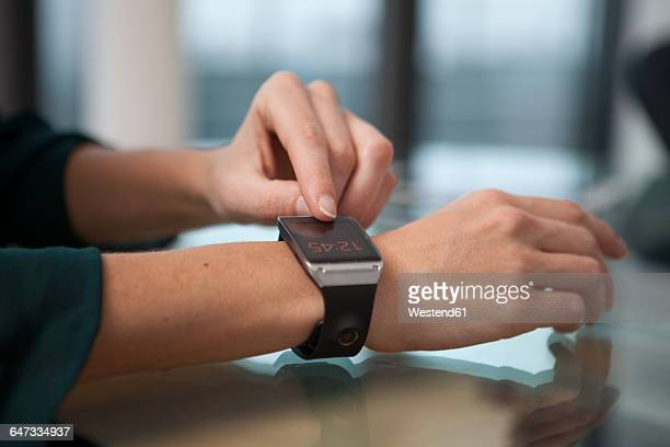 Smart watch on arm of mid adult woman
