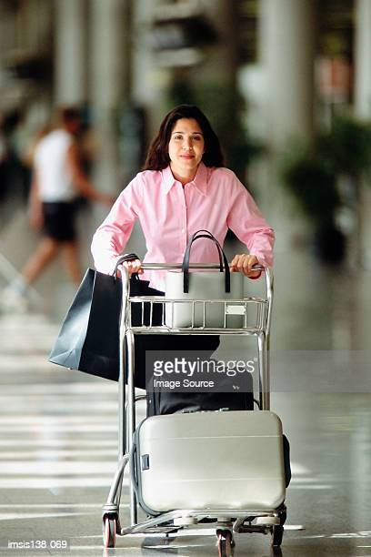 Smart woman with trolley
