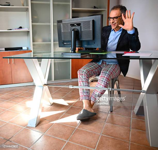 smart working in pajama pants and slippers - pajamas stock pictures, royalty-free photos & images