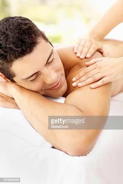 Smart young man receiving a shoulder massage