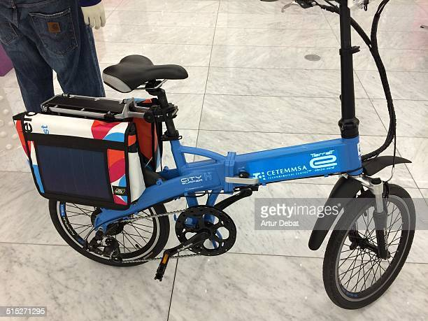 Smartbike connected to smartphone with solar panels on the sides and LEDs signals on the backpack for traffic circulation
