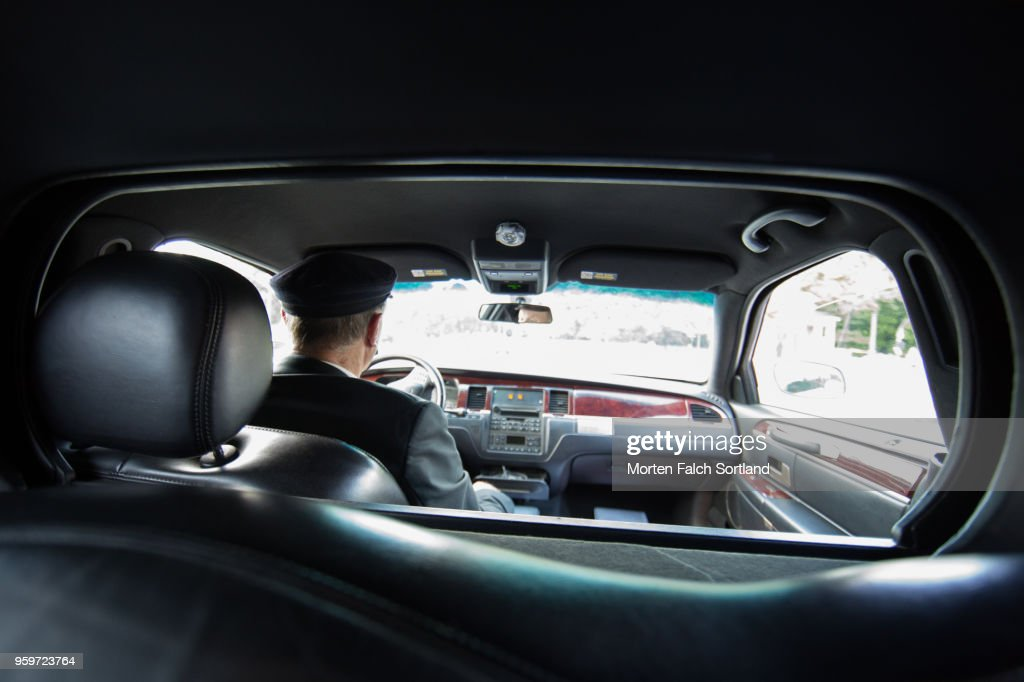 A Smartly Dressed Man Drives a Limo to a Wedding Ceremony in Berlin, Germany Summertime : Stock-Foto