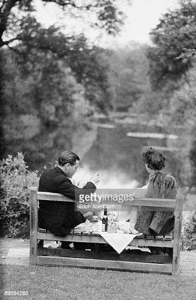 A smartlydressed couple share a small bottle of champagne at the Glyndebourne opera festival in East Sussex 28th May 1959