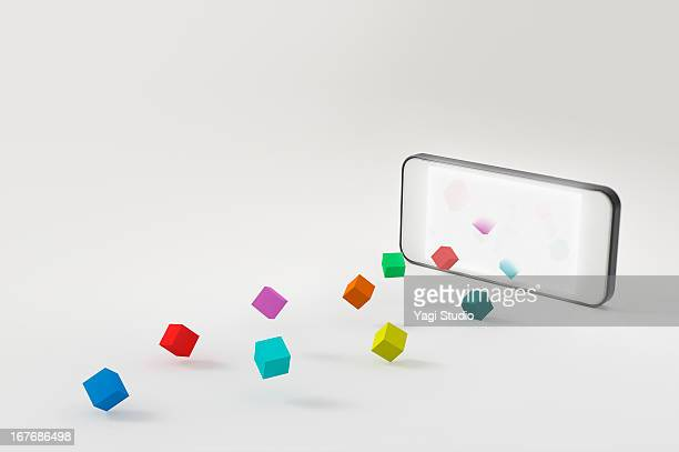 A smartphone and a block