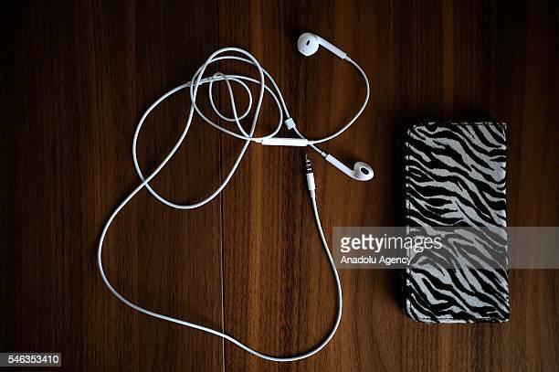 A smartphone and earphones are seen on the table of minimalist Saeko Kubishiki in Fujisawa Kanagawa Prefecture in the southern of Tokyo Japan on June...