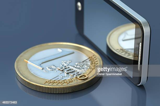Smartphone beside a one euro coin
