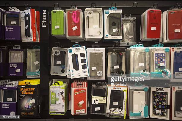 Smartphone cases hang on display inside an Orange SA mobile phone store in Marseille France on Tuesday Dec 22 2015 Orange is in early talks about...