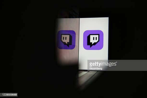 Smartphone displays a logo for the Twitch streaming app, operated by Amazon.com Inc., in this arranged photograph in London, U.K., on Thursday, Sept....