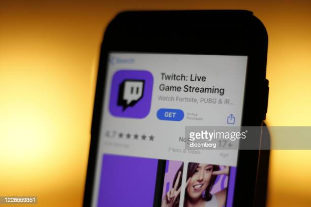 Smartphone displays the Apple Inc. App Store page for the Twitch streaming app, operated by Amazon.com Inc., in this arranged photograph in London,...