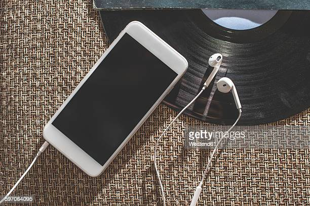 smartphone, earphones and a record - mp3 player stock pictures, royalty-free photos & images