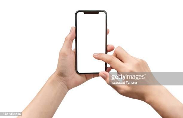 smartphone in female hands taking photo isolated on white background - human body part stock-fotos und bilder