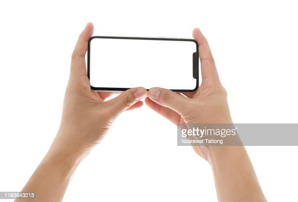smartphone in female hands taking photo isolated on white background - fotohandy stock-fotos und bilder