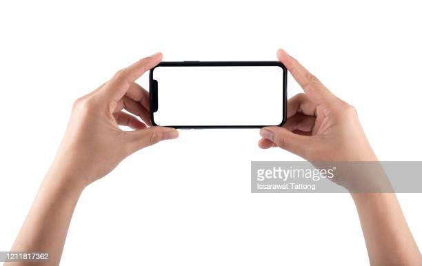 smartphone in female hands taking photo isolated on white background - human hand stock pictures, royalty-free photos & images