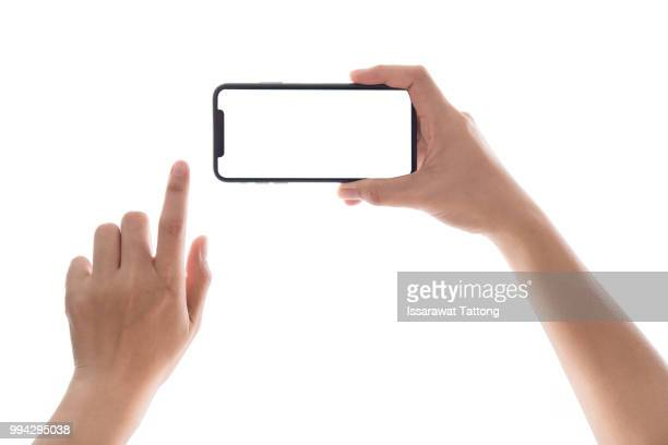 smartphone in female hands taking photo isolated on white blackground - halten stock-fotos und bilder