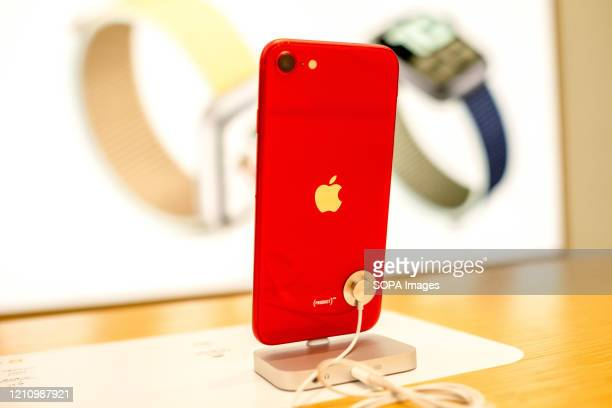 Smartphone iPhone SE red version seen displayed at an American multinational technology company Apple store Apple launched sales of its latest iPhone...