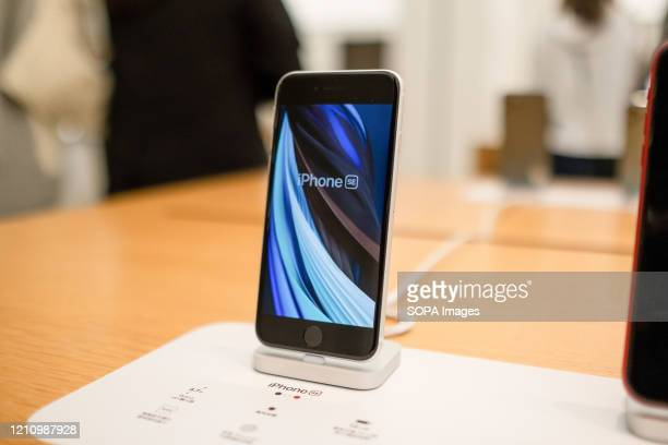 Smartphone iPhone SE white version seen displayed at an American multinational technology company Apple store Apple launched sales of its latest...