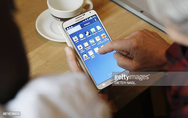 A smartphone is operated during a meeting of the Austrian project 'Qualitaetszeit' helping elderly in how to use modern communication devices like...