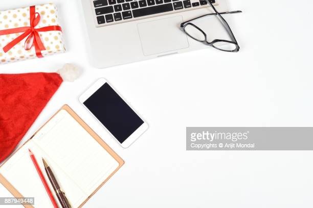 Smartphone mock up with Christmas gifts at workplace, Christmas mobile application concept, copy space