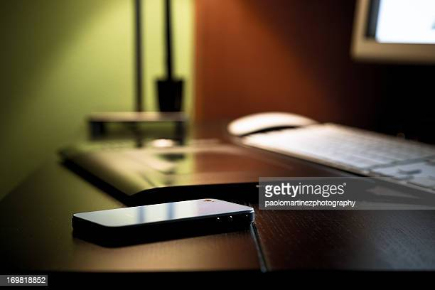 smartphone on black desktop