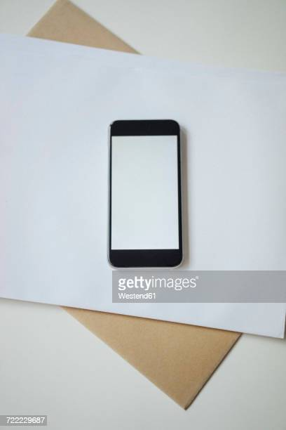 Smartphone on envelopes