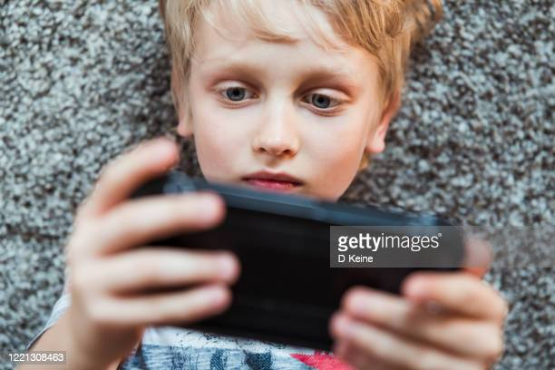 smartphone - only boys stock pictures, royalty-free photos & images