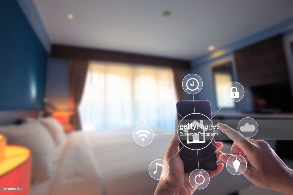 Smartphone remote home control system app. Bed Room interior in background. : Stock Photo