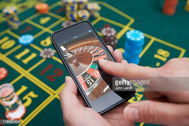 smartphone roulette - gambling stock pictures, royalty-free photos & images