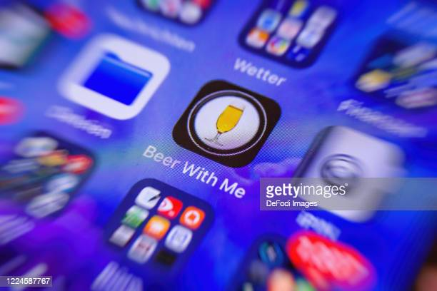 Smartphone screen is seen with the App Beer with me on May 11, 2020 in Bochum, Germany.