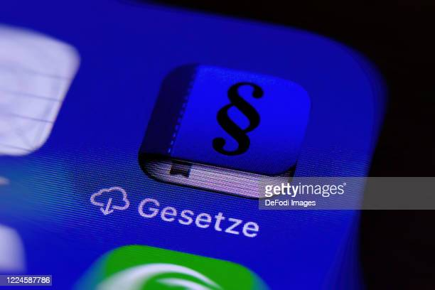 Smartphone screen is seen with the App Gesetze on May 11, 2020 in Bochum, Germany.