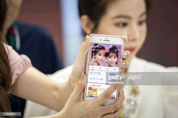 Smartphone screen shows Alibaba Group Holding Ltd.'s e-commerce platform Taobao page for livestreamers known professionally as Chu Fei and Chu Ran at...