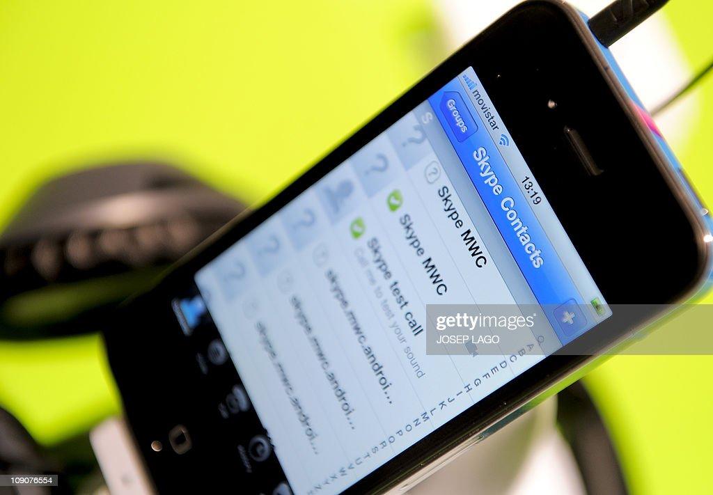 A smartphone shows a Skype application a : News Photo