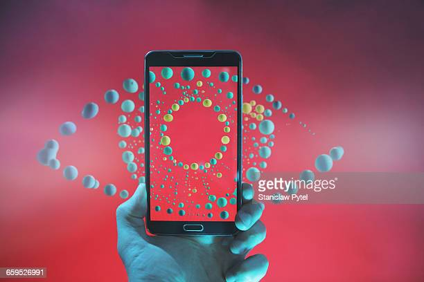 smartphone taking picture of abstract eye - atom stock photos and pictures