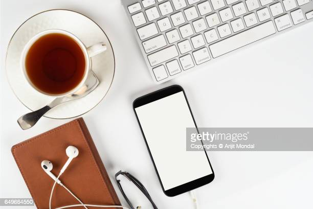 Smartphone White Background Blank White Screen with Computer Keyboard and Tea Cup