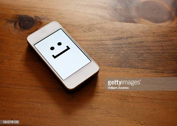 Smartphone with emoticon smile face
