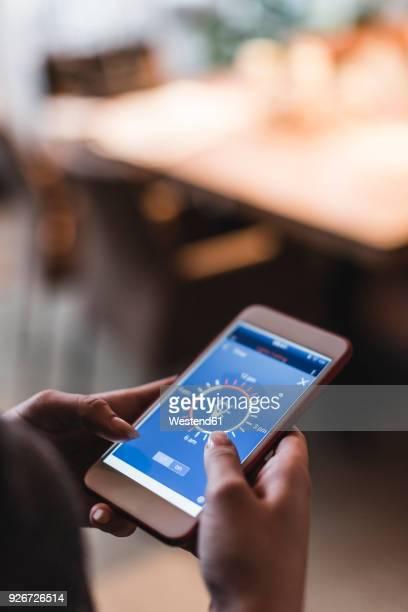 smartphone with smart home control functions in hands - con eficaz consumo de energía fotografías e imágenes de stock