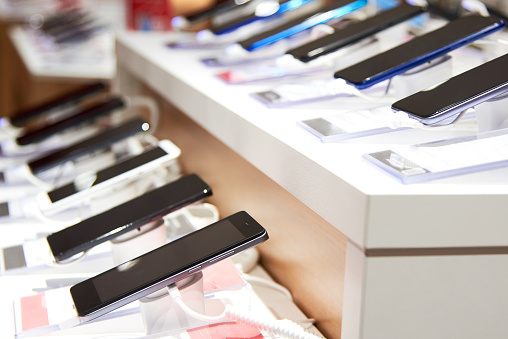 Smartphone's on the counter of a electronics store 1138251272