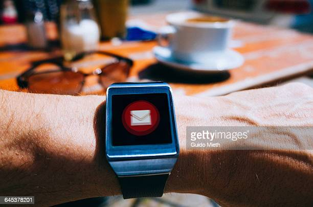 Smartwatch showing email icon.