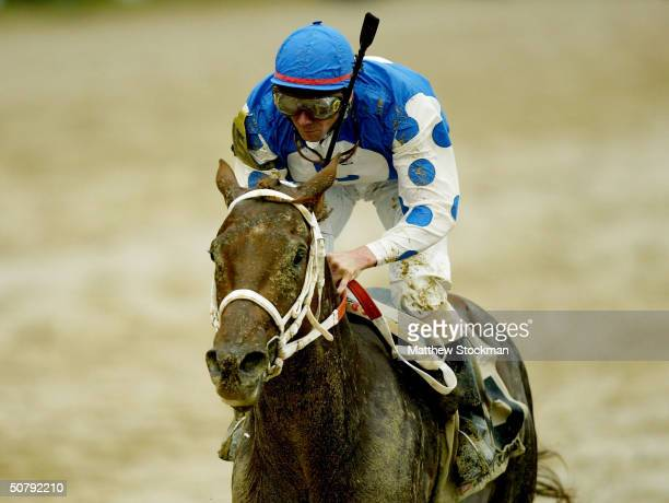 Smarty Jones riden by Stewrat Elliott crosses the finish line to win the 130th Kentucky Derby May 1 2004 at Churchill Downs in Louisville Kentucky