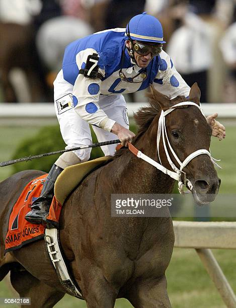 Smarty Jones with jockey Stewart Elliot aboard crosses the finish line to win the 129th running of the Preakness Stakes at Pimlico Race Course in...