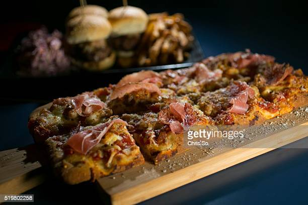 Smash flat bread pizza with pulled chicken prosciutto ham tomato sauce and parmesan cheese and beef sliders fries and dilled coleslaw can be ordered...