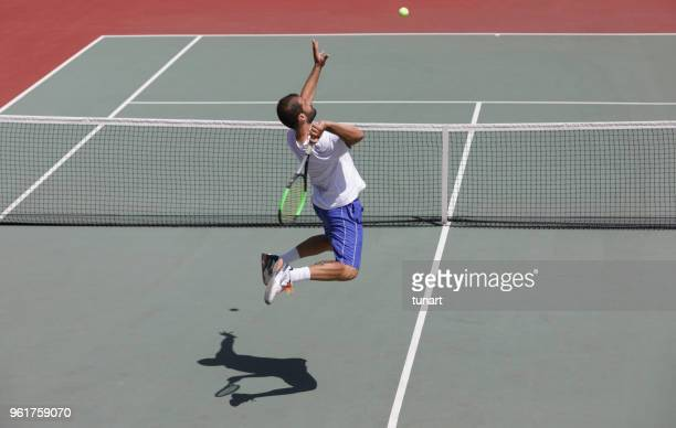 smash shot in tennis - tennis player stock pictures, royalty-free photos & images