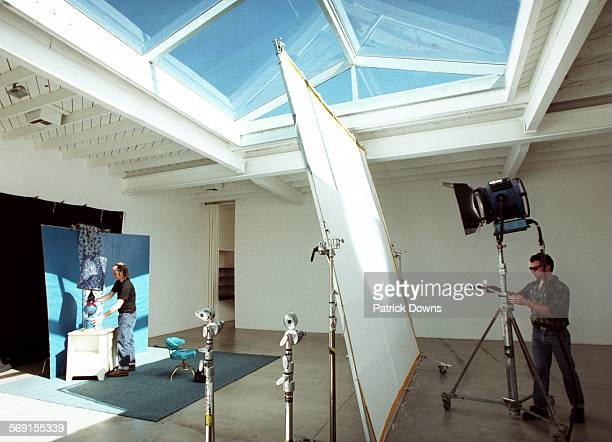 Smashbox.#4.PD.4–19: Photographer David Jensen works on the set as his assistant Creston Funk aim the light, while readying the set at SMASHBOX Photo...