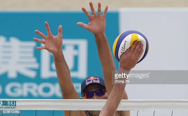 A smashed ball by Aleksandrs Samoilovs of Latvia with Janis Smedins of Latvia during the match against Philip Dalhausser of USA and Nicholas Lucena...