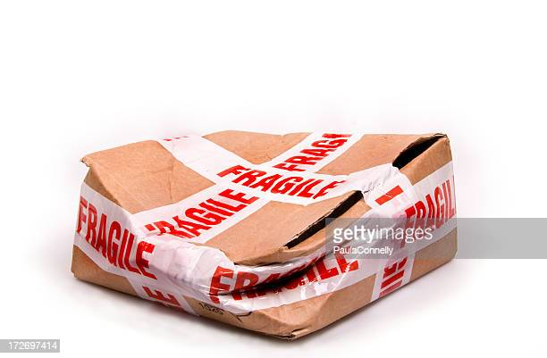 a smashed box with fragile tape all around it - fragile sign stock pictures, royalty-free photos & images