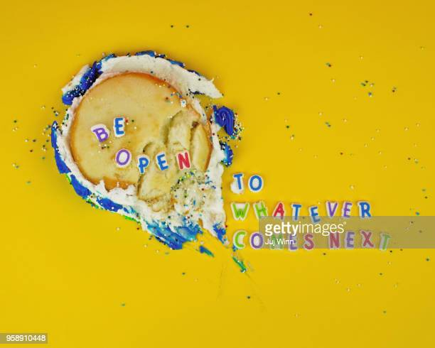 smashed cake on yellow background with candy letters - quotation text stock photos and pictures