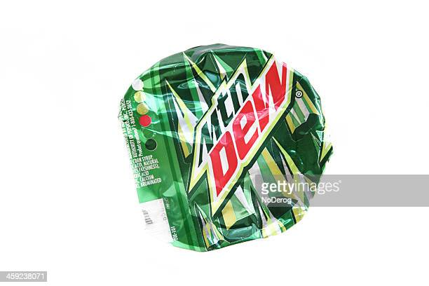 smashed flat mountain dew can - roadkill stock photos and pictures